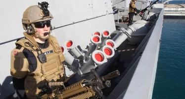 Norwegian marines patrol a frigate docked at Limassol