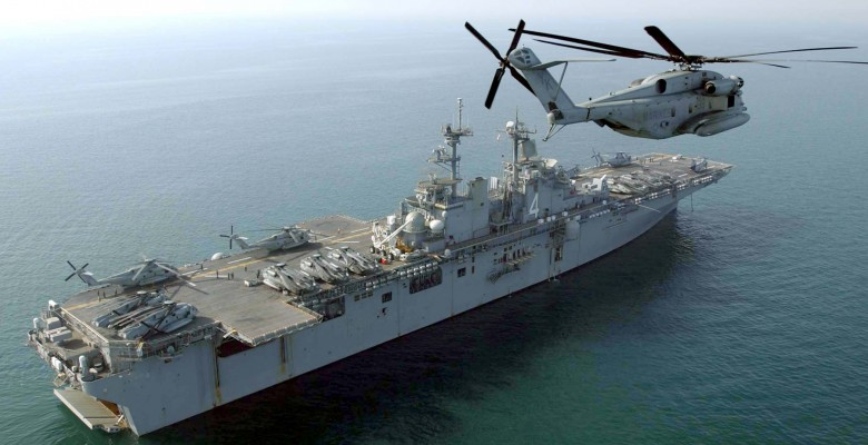 US_Navy_040219-N-7912E-005_An_U.S._Marine_Corps_CH-53E_Super_Stallion_flies_past_the_amphibious_assault_ship_USS_Boxer_(LHD_4)