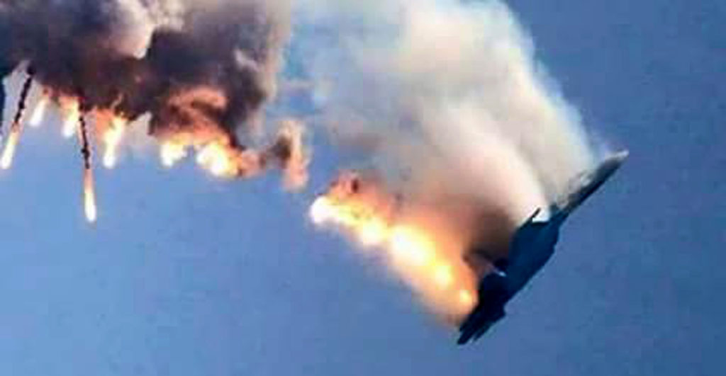 An image grab made from a video shows a burning Russian fighter jet coming down after being shot down near the Turkish-Syrian border, in Hatay on November 24, 2015. NATO member Turkey shot down a Russian fighter jet on the Syrian border today, threatening a major spike in tensions between two key protagonists in the four-year Syria civil war. AFP PHOTO / IHLAS NEWS AGENCY ***TURKEY OUT*** / AFP / IHLAS NEWS AGENCY / - (Photo credit should read -/AFP/Getty Images)