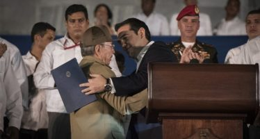 epa05653275 A handout picture shows Greek Prime Minister Alexis Tsipras (R) greeting Cuban President Raul Castro (L) during the farewell ceremony for the late Cuban former President Fidel Castro at the Plaza de la Revolution of Havana, Cuba, 29 November 2016.  Cubans are gathering at the Jose Marti Monument in Havana's Plaza of the Revolution to bid farewell to Cuban former President Fidel Castro. Castro died at the age of 90 on 25 November.  EPA/ANDREA BONETTI / GREEK PRIME MINISTER'S PRESS OFFICE / HANDOUT  HANDOUT EDITORIAL USE ONLY/NO SALES