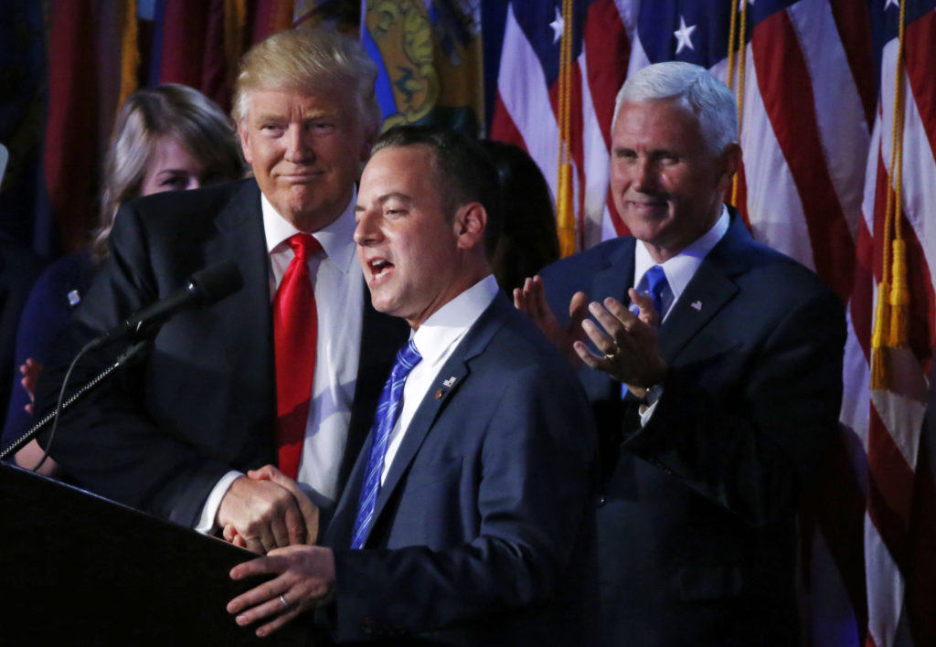 U.S. President elect Donald Trump shakes hands with Republican National Committee Chairman Reince Priebus (C) as Vice President-elect Mike Pence (R) looks onat election night rally in Manhattan, New York, U.S., November 9, 2016. REUTERS/Jonathan Ernst