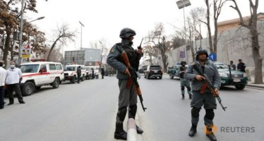 afghan-policeman-stand-guard-at-the-site-of-a-blast-and-gunfire