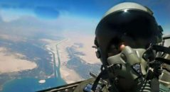 Egyptian air force pilot takes a selfie during celebrations of Egypt's New Suez Canal