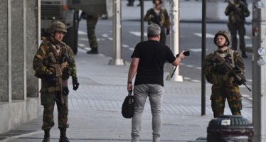 Belgian Army soldiers approach a man outside Central Station after a reported explosion in Brussels on Tuesday, June 20, 2017. Belgian media are reporting that explosion-like noises have been heard at a Brussels train station, prompting the evacuation of a main square. (AP Photo/Geert Vanden Wijngaert)