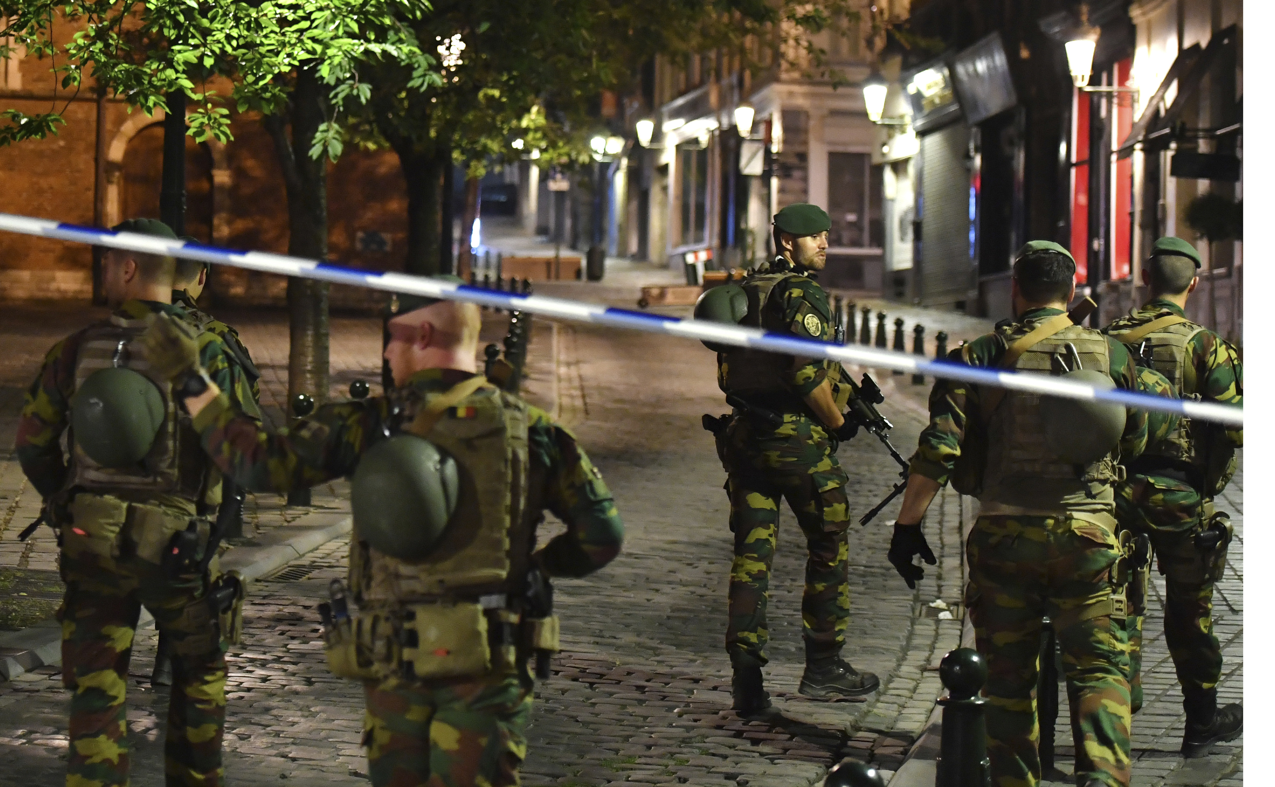 Belgian Army soldiers patrol near Central Station in Brussels after a reported explosion on Tuesday, June 20, 2017. Belgian media are reporting that explosion-like noises have been heard at a Brussels train station, prompting the evacuation of a main square. (AP Photo/Geert Vanden Wijngaert)