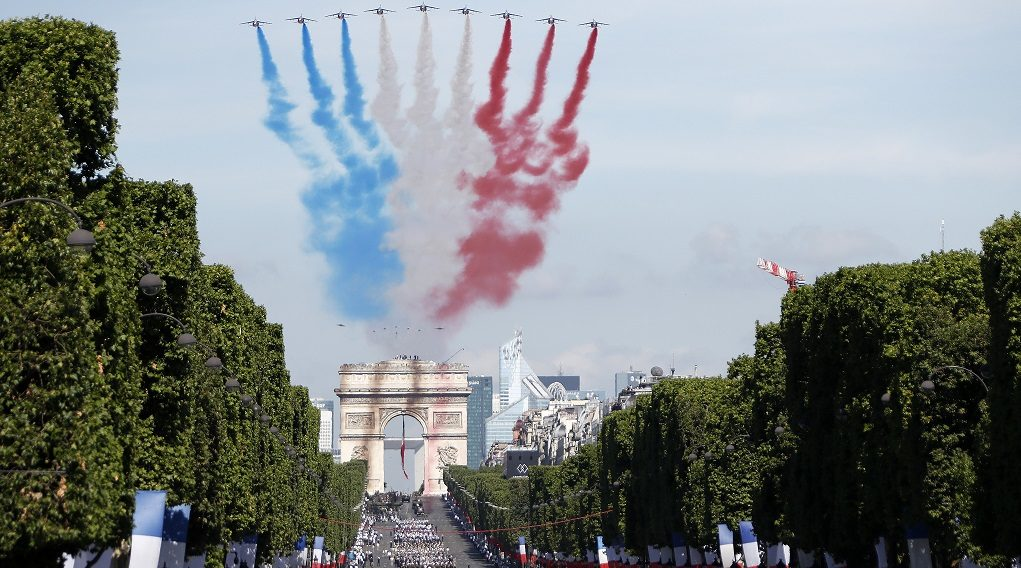 epa06086382 Alpha jets fly over the Arc de Triomphe leaving a red, white and blue trail during the annual Bastille Day celebrations in Paris, France, 14 July 2017. Bastille Day, the French National Day, is held annually on 14 July to commemorate the storming of the Bastille fortress in 1789.  EPA/IAN LANGSDON